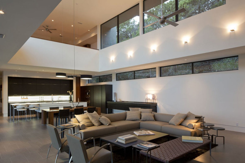modern home surrounded by oak trees
