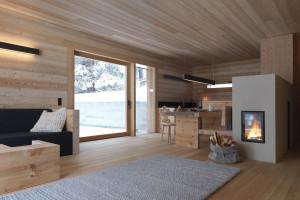 Minimalist wooden retreat by EM2 Architekten