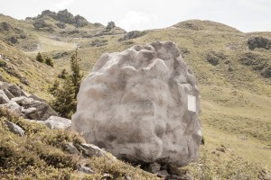 Small Wooden Cabin hidden inside a projected concrete rock
