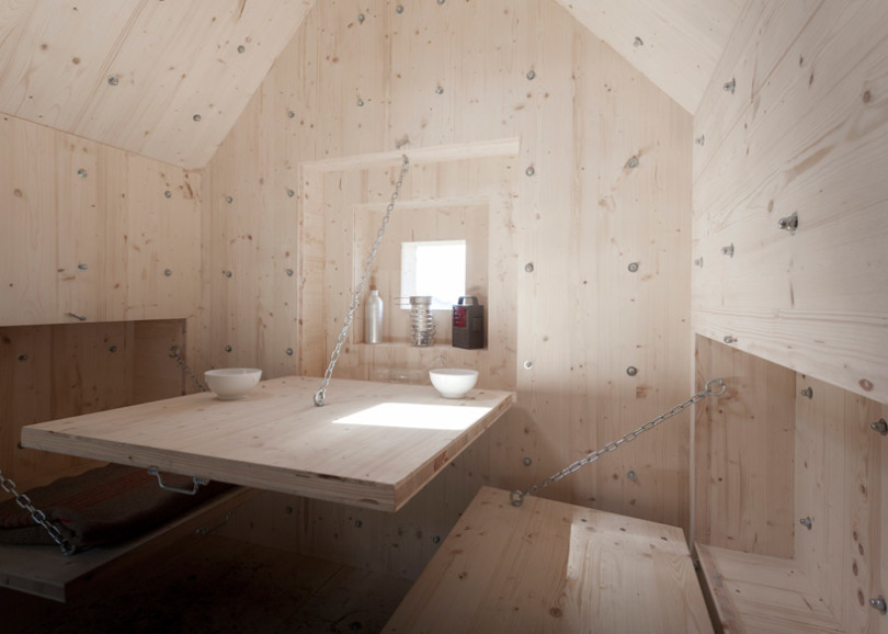 Small Wooden Cabin hidden inside a projected concrete rock Antoine Shelter-04