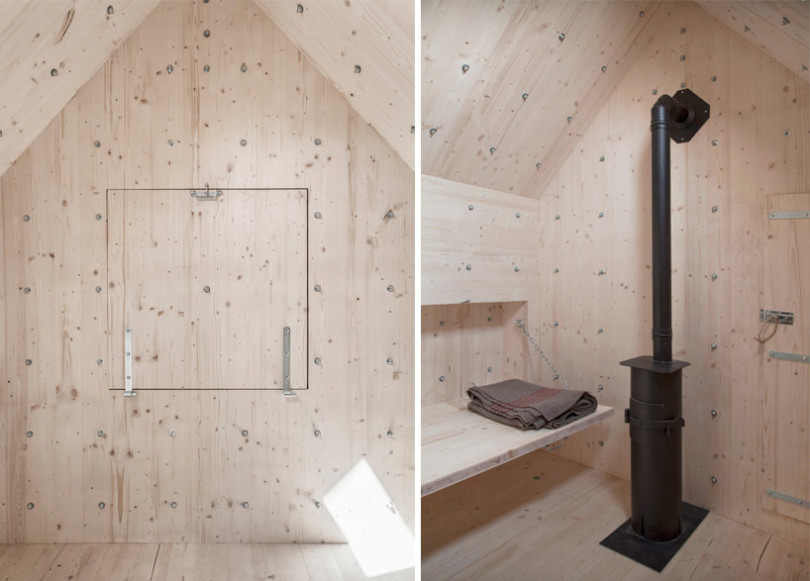 Small Wooden Cabin hidden inside a projected concrete rock Antoine Shelter-05