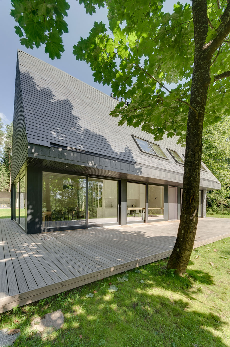 This House With Bluestone Walls Overlooks The Landscape: Comfortable House In Trakai By AKETURI ARCHITEKTAI